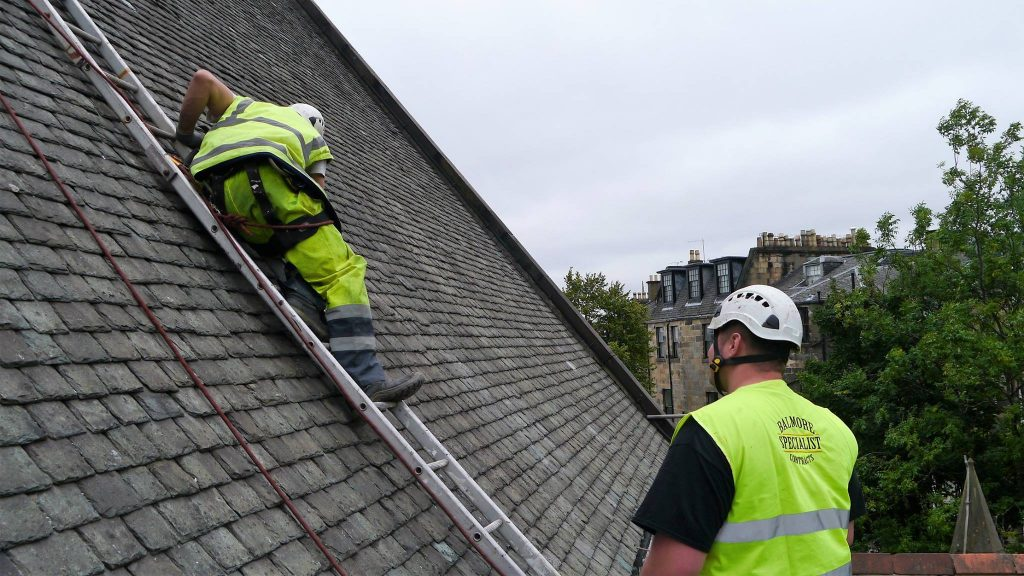 Glasgow Roofer fixing a slate roof